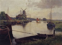 river with moored boats, groningen, the netherlands by erwin spindler