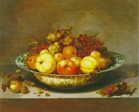 still life of fruit in a blue and white bowl by johannes bouman