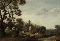 a wooded landscape with cattle grazing on a bank by gysbert gillisz de hondecoeter