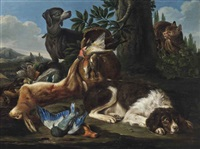 a hound and a spaniel with game in a landscape by david de coninck