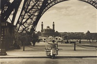 vendor at the eiffel tower by ilse bing