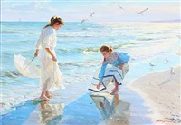 two girls looking for amber on the beach by aleksandr averin