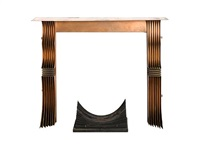 a fire surround and grate by tom dixon