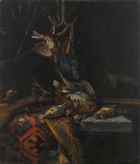a still life with a woodcock, a kingfisher and songbirds, all on a stone table draped with a tapestry, together with a gun by cornelis van lelienbergh