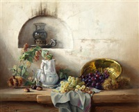 still life of fruit, a jug and glass on a table, a lamp in an alcove behind by robert chailloux