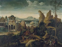 a mountainous landscape with the feast of herod and the dream of joseph by herri met de bles
