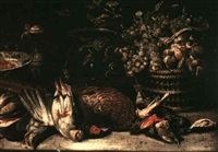 a still life with dead song birds, a pheasant and a pigeon on a table with a wicker basket of grapes, a porcelain bowl by jan-baptist tyssens