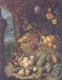 a basket of grapes and other fruit on a stone ledge with peaches, grapes, pears and other fruit and flowers by a wall by hendrik schoock