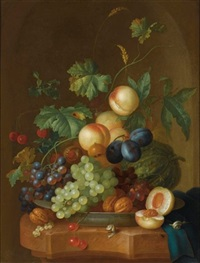 a still life with peaches, grapes, plums, a melon, cherries, wallnuts, chestnuts on a wan-li porcelain plate, together with two snails on a marble ledge, draped with a blue cloth by johannes christianus roedig