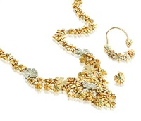 a necklace and a pair of earrings (set of 2) by sigal shohat