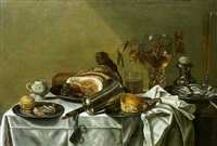 a pronk still life with a lemon and a slice of ham, a leg of ham, a bun and a knife and oysters on the pewter plates with other objects on a draped table by pieter van berendrecht