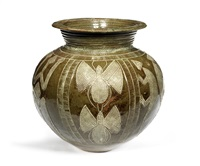 pot decorated with small creatures by ladi kwali
