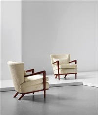 pair of 'écusson' armchairs by jean royère