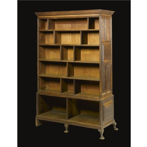 a double sided bookcase and display cabinet by edwin henry lutyens