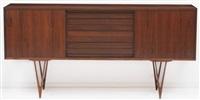 enfilade à deux portes coulissantes et tiroirs by erik buch