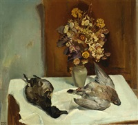 still life with flowers and two dead ducks on a table by harrie kuyten