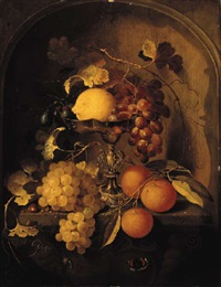 a lemon, grapes and plums on a tazza, with oranges, grapes and a hazelnut with a snail and a butterfly by laurens craen