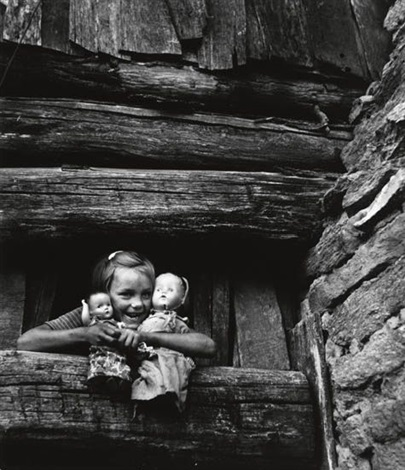 child hugging her doll blue ridge mountains north carolina by w eugene smith