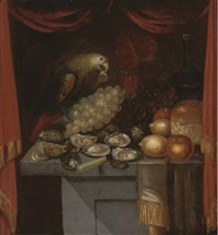 a parrot, oysters, lemons, grapes, bread and wine on a partially draped table behind a red curtain by n. adama