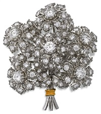 a brooch designed as a bouquet of flowers by frederico buccellati