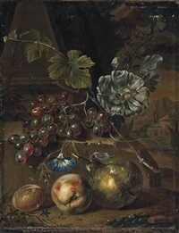 a peach, a plum and a pear, with grapes on a stone ledge, an italianate landscape beyond by willem grasdorp