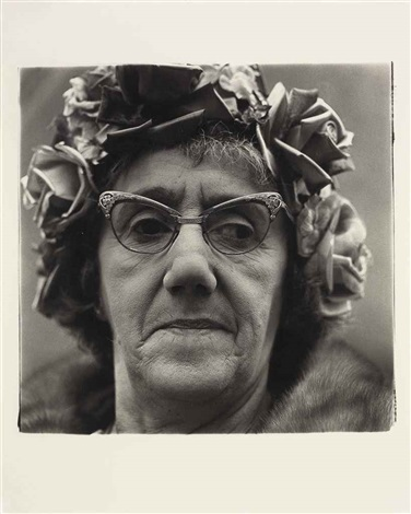 woman in a rose hat nyc by diane arbus