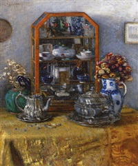 a collection of ornaments in a glass case on a table by josef köpf
