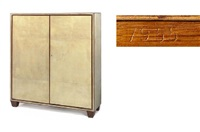 a parchment and walnut armoire, circa 1934 by jean-michel frank
