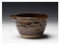 an iron-glazed lipped bowl by ishiguro munemaro
