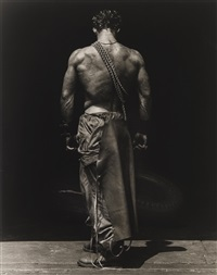 fred, backview with chain (body shop), hollywood by herb ritts