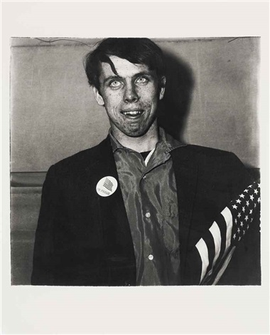 patriotic young man with a flag nyc by diane arbus
