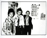 the clash (mick jones, paul simonon, joe strummer) by sheila rock