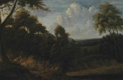 a wooded landscape with a huntsman on a track by jacques d' arthois