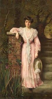 a portrait of a lady in a garden wearing a pink dress holding an iris by thomas benjamin kennington