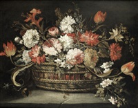 roses, tulips, orange blossom and other flowers in a basket on a stone ledge; and narcissi, carnations, roses and other flowers in a basket on a stone ledge, a landscape beyond (pair) by margherita caffi