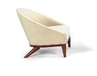 an upholstered rosewood bergère, circa 1938 by jean royère