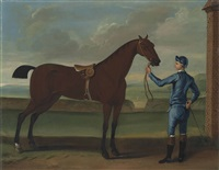 a jockey in blue racing silks and a chestnut racehorse in a landscape by richard roper
