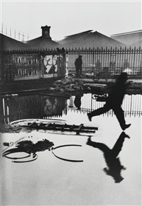 behind the gare saint-lazare, paris by henri cartier-bresson