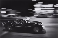 steve mcqueen driving his jaguar at night, california by john dominis