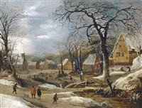 a winter landscape with figures by a frozen river in a village by frans de momper