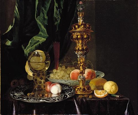 a still life of peaches grapes a lemon a segment of orange hazelnuts and a bread roll together with a roemer a large gold pronckblokaal and a silver platter all laid out on a draped table by simon luttichuys