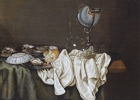 stilleben mit austern, einem nautiluspokal, einer chinaporzellanschale und gläsern by gerrit willemsz heda