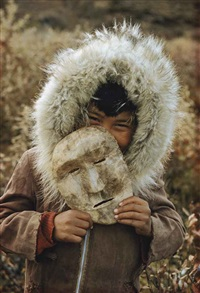 a nunamiut boy and mask, alaska by thomas j. abercrombie