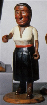 figure of a woman in red, white and black dress by adelard cote