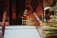 untitled (santa claus figure on porch) by william eggleston