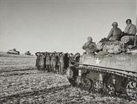 belgique. région de bastogne. 23-26 décembre - soldats allemands capturés par les forces américaines by robert capa