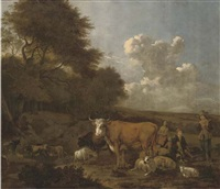 an extensive wooded landscape with herdsmen on a track by albert jansz klomp