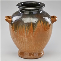 two-handled hammered urn with cat's eye and gunmetal drip glaze by fulper pottery