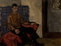 man on red sofa by yiannis migadis