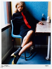 kate in blue cafe by mario testino